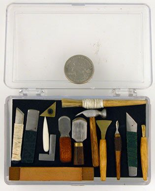 Jeff Peachey miniature bookbinding tool set, includes English paring knife, a Peachey paring knife, a French knife, a Peachey style French knife, a backing hammer, an engineers square, a triangle, a bone folder, a wood handled scalpel, a large and small lifting knife, a cord wrapped paste brush, a pallet, a heart finishing tool and a strop. $650.