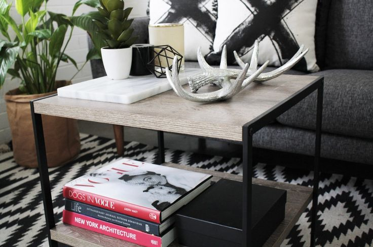 How to style your coffee table | Modern Eclectic - Monochromatic color pallet with bold color for contrast. Use your favourite coffee table books with bold contrasting colours and beautiful front covers. Pick a variety of different shaped items that create visual interest. Visit our blog for more coffee table styling inspiration.