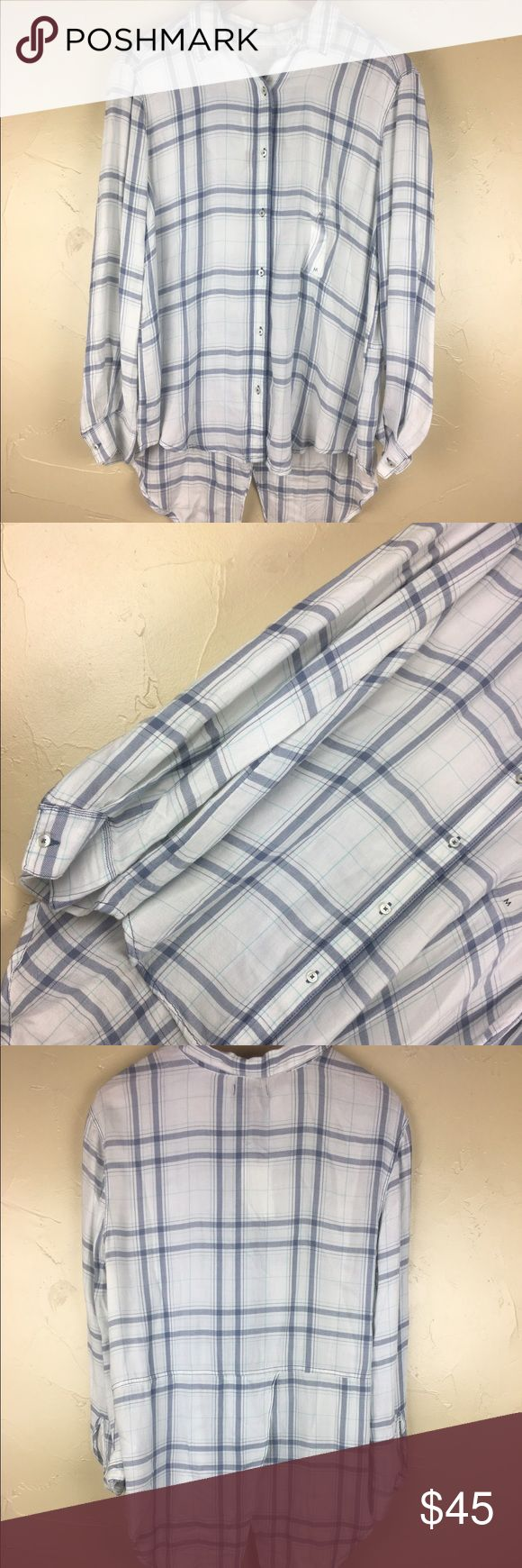 Calvin Klein Jeans button down shirt Size M NWT Calvin Klein Jeans button down size Medium with beautiful back low high type of shirt. See pictures for more details Calvin Klein Jeans Tops Button Down Shirts