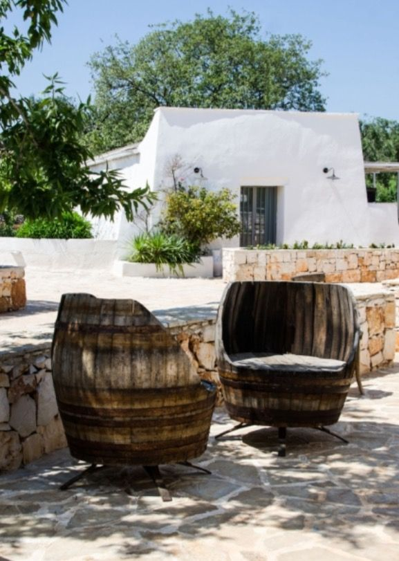 "These quirky outside chairs made from an old wind barrel, are from our feature ""Apulian Dream"""