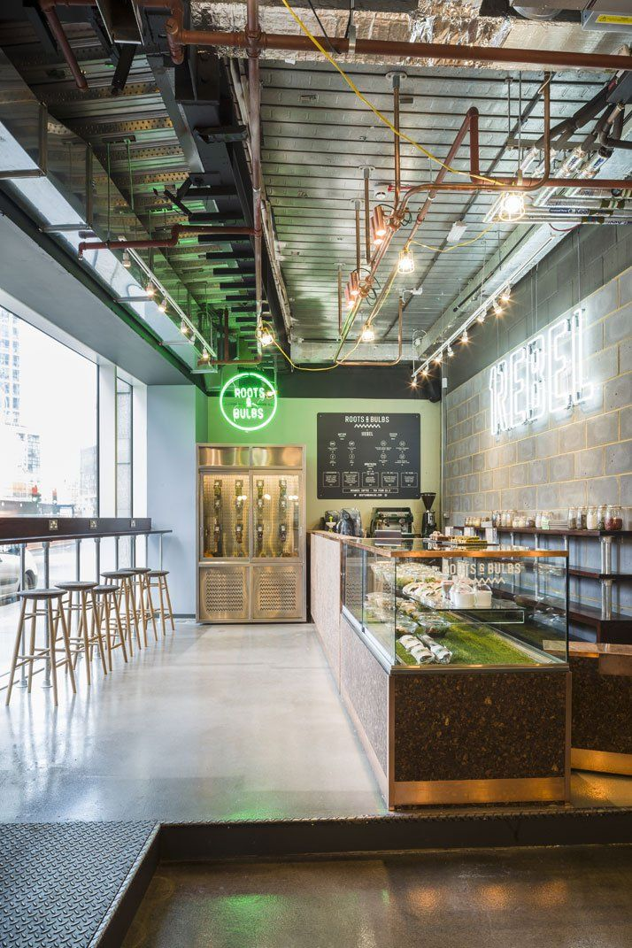 In the reception area, healthy food and freshly-pressed juices are served by Roots & Bulbs juice bar. The bar area was designed by k-studio. Photo by Gareth Gardner.