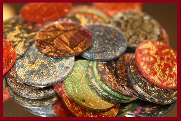 Embossed Material Discs.