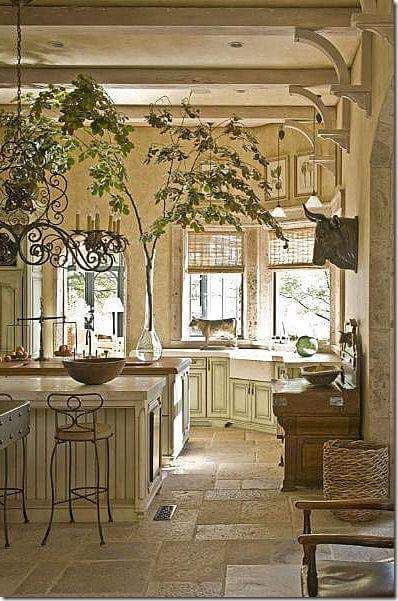 Stone floor, big tree branch(?) and bracketedd beams in this beautiful kitchen.
