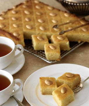 It is called in Morocco Shamiya [SH U MEE YA], a lovely moist and soft cake, made of semolina as main ingredient.