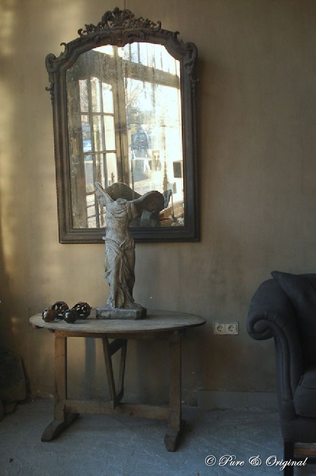 Winged Victory of Samothrace statue on an antique vintners table.