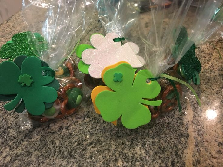 Home made shame rock pretzel snack bags/namesake item. Homemade by: Me ;-) Requires 1-large bag pretzels  3 or 4 bags of chocolates for melting  1-Seasonal colored Bag of M&M 50-Cellophane bags 6ft-colored Ribbon 50-Seasonal shamrock decor to dress up ribbon & cellophane bag
