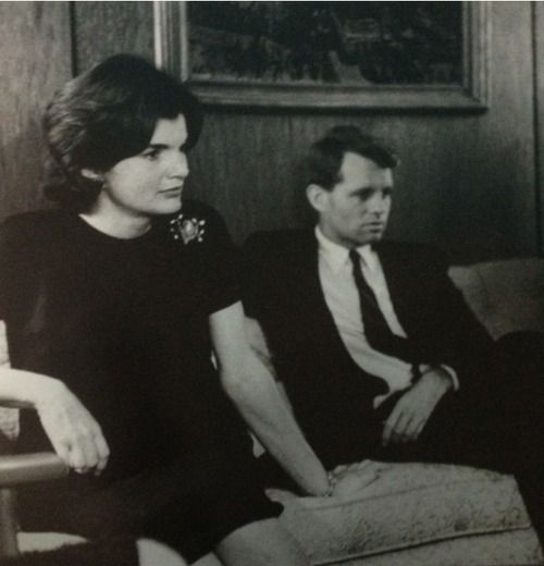Bobby with his sister-in law watching the debate of senator john f. kennedy in 1960 for the president of the united states.