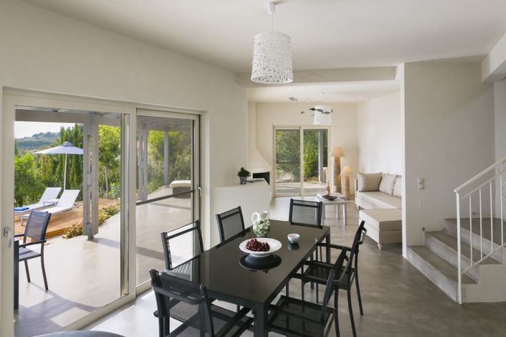 A contemporary and modern exterior is tempered inside with exposed stone walls, pastel shades, polished cement floors and comfortable furnishings, creating a clean, bright and relaxing ambiance.