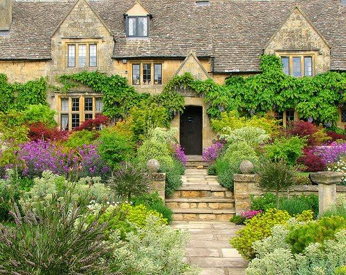 This is my dream home exterior. Classic British stone house with overgrown plantation.