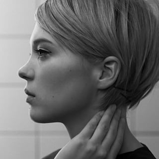 Blow dry, straighten, and tuck the longest layer behind the ear for a short bob effect. | 17 Things Everyone Growing Out A Pixie Cut Should Know