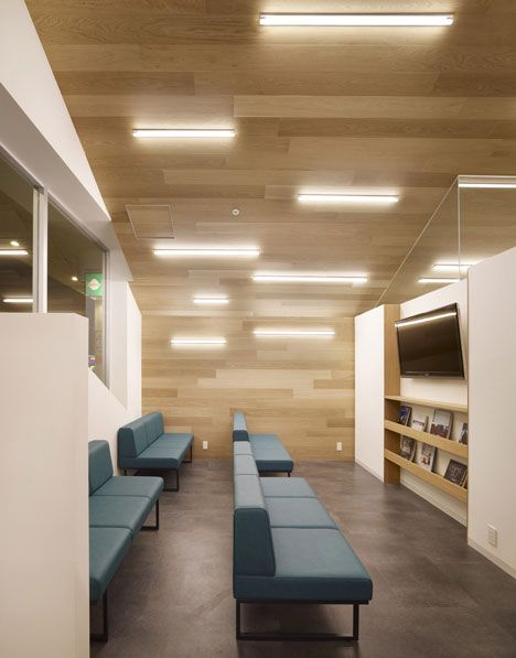 Array of fluorescent tubes on sloping ceiling