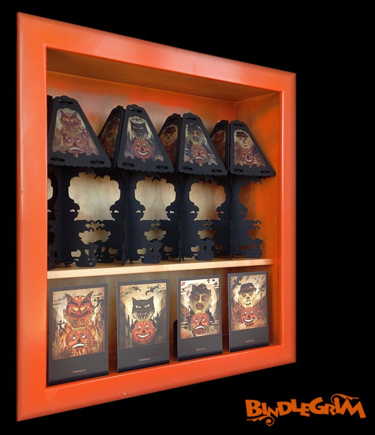 Vintage-style lamps (a set that combine a separable candlestick base with a pendant lamp on top) shown here in orange display cabinet with corresponding postcard characters.