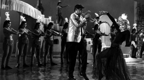 "stunningtips: "" Keeping Score Swinging sixties: In Teesri Manzil, RD Burman brought rhythm, brass, woodwind to the fore. Actor Shammi Kapoor and actress Helen in film Teesri Manzil. """