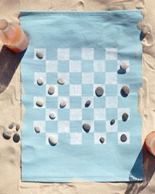 Leave bulky gear at home and hit the beach with a compact, portable game board fashioned from a place mat....plus seashells :)