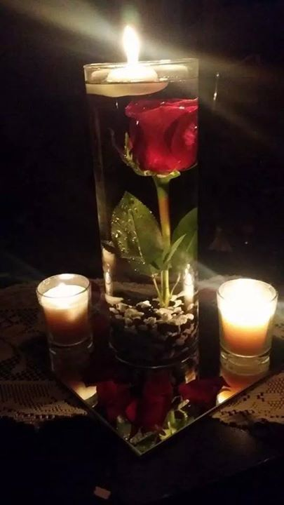 My wed table center piece... roses I got from you love them