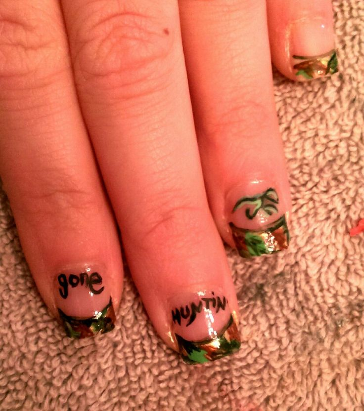 Hunting and camo nail art by Nails by April in Berthold, North Dakota. Browning symbol and all hand painted.