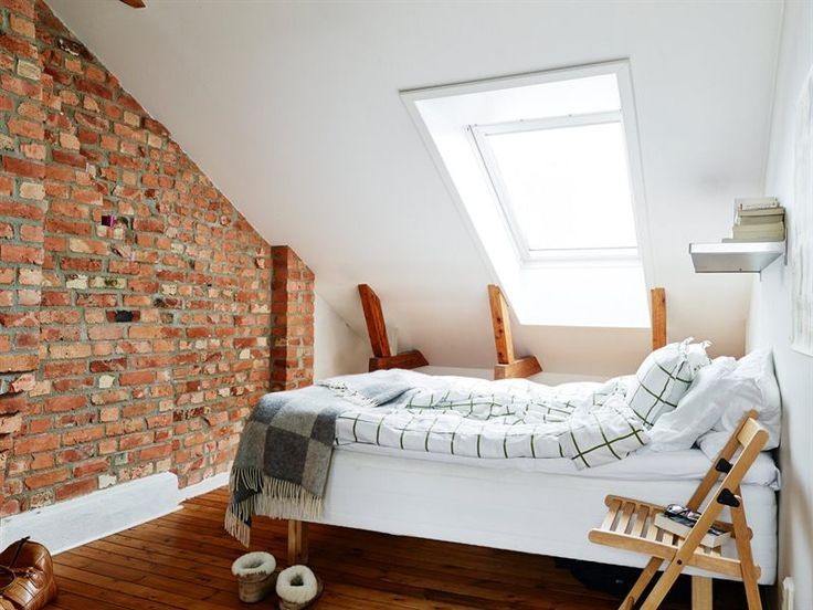 bedroom. white, raw brick and warm toned wood