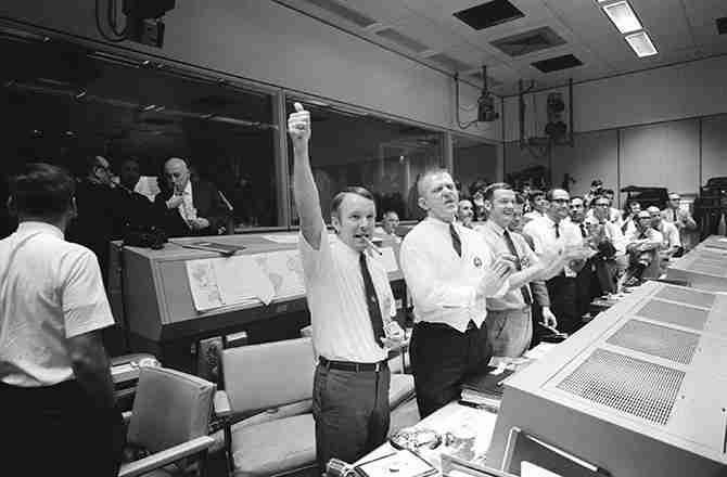 Apollo 13 flight directors celebrate the successful splashdown of the Apollo 13 command module. | NASA