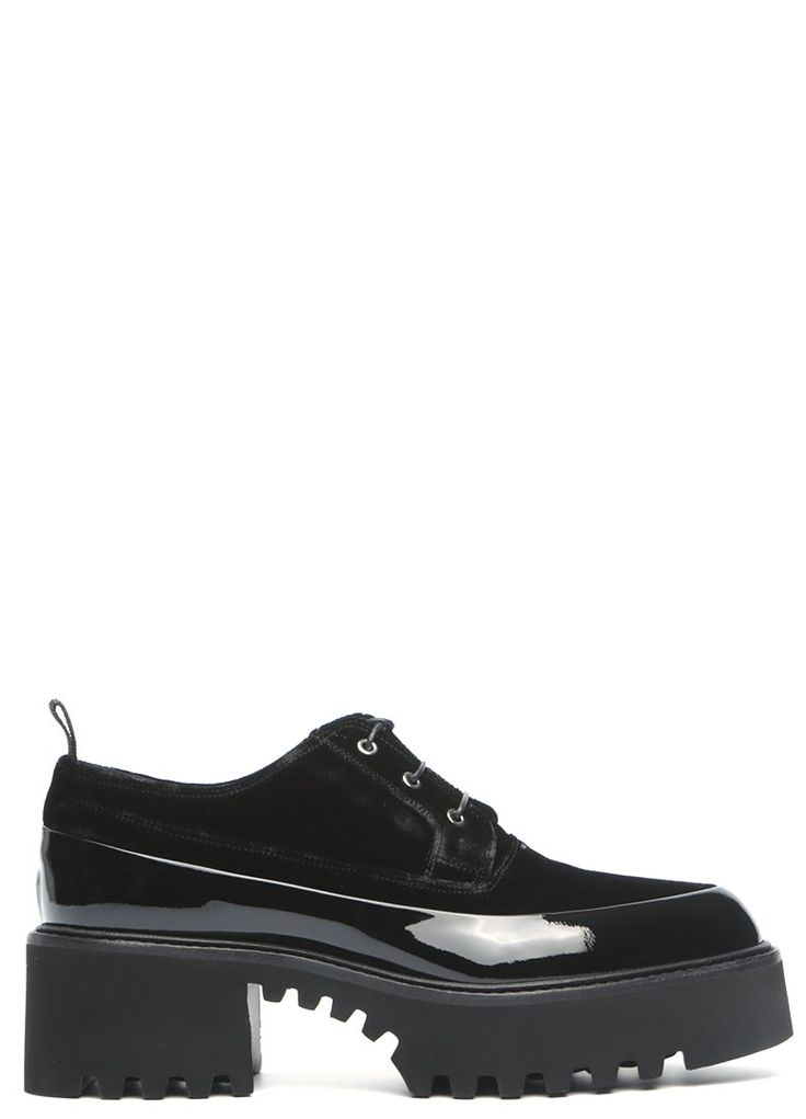 Velour and patent leather lace up platform shoe from Premiata. A round toe, lace up closure. Metallic eyelets. Pull loop at heel collar. Partly jagged extra light water resistant sole. Leather lining.  Item Code: 4614  Heel/platform high: 7 cm / 2 cm  Materials: leather, velour, rubber  Made in Italy