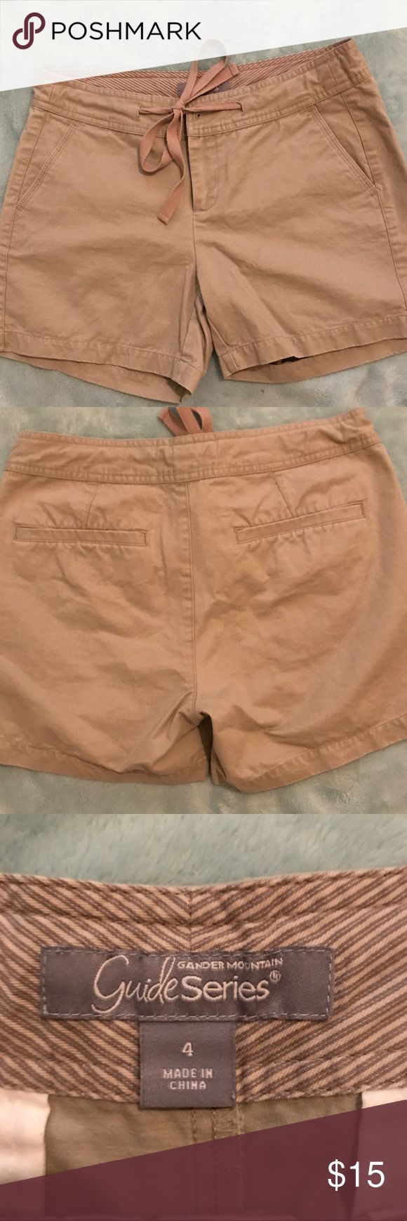 GANDER MOUNTAIN GUIDE SERIES WOMEN'S SHORTS SIZE 4 Gander Mountain Guide Series khaki shorts with drawstring and button waist- size 4 ladies- excellent condition 🛍 BUNDLE & SAVE!! 4 item limit per bundle due to shipping weight restrictions Gander Mountain Guide Series Shorts