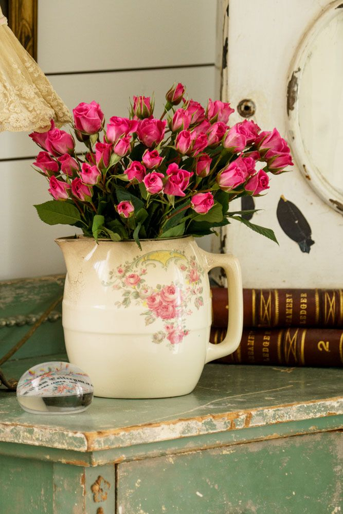 Fill a pretty floral pitcher with coordinating blooms.