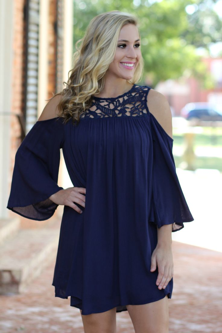 Lavish Boutique  - Keep You Guessing Cold Shoulder Dress: Navy , $44.00 (http://lavishboutique.com/keep-you-guessing-cold-shoulder-dress-navy/)