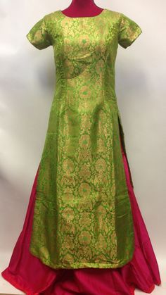 Green and pink Bollywood style brocade lehenga suit is made with glitzy foliage patterns enriched with fancy thread work woven design on stylish brocade Kurta. Contrast plain pink silk skirt amplifies