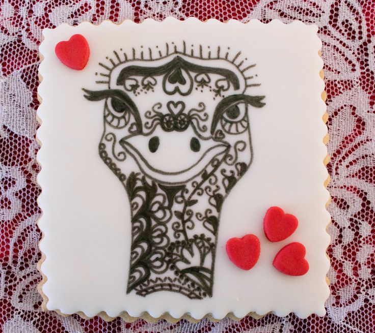 A quirky hand-drawn Zentangle ostrich with tiny red fondant hearts