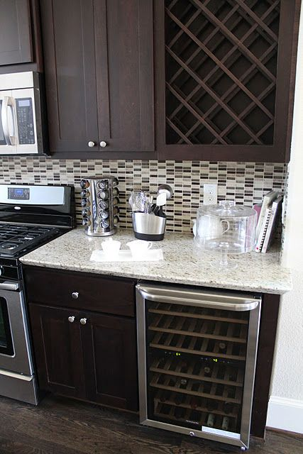 Love Love Love...The cabinets, the colors, the appliances, the countertops, the tiled backsplash, the wine fridge, everything.