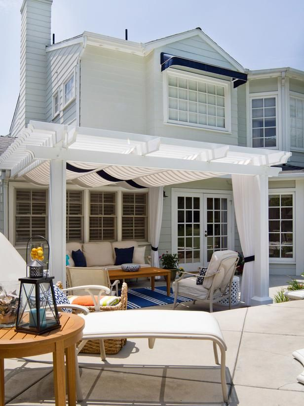 a shaded pergola offers a perfect spot for relaxing or entertaining, while lounge chairs serve up a little poolside seating
