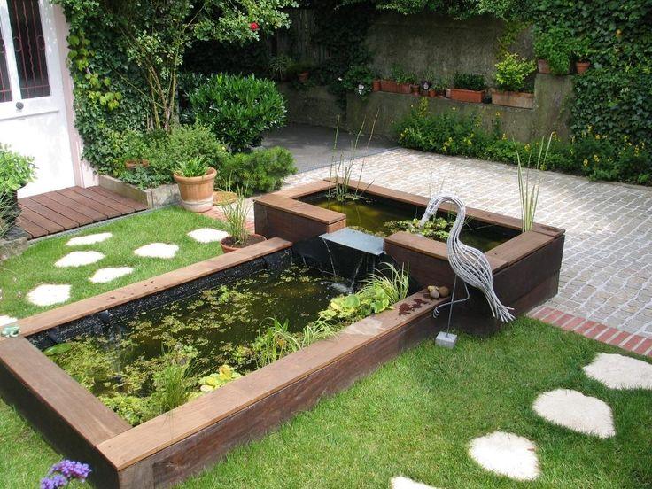 Une cascade sur une plaque en inox entre deux bacs for Cascade bassin jardin