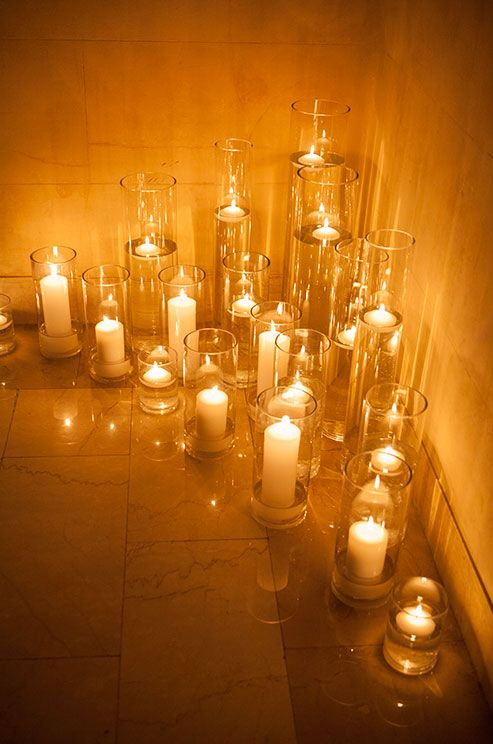 Pillars and floating candles project and romantic amber glow in a corner of this venue.