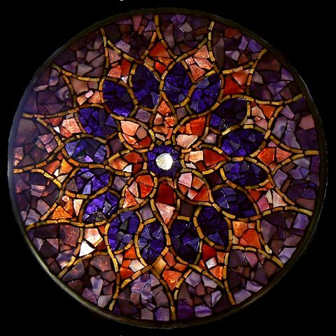 This is a glass mosaic mandala by David Chidgey call Dusky Sun  I love the colors he used in this and the way the light comes through the colors with varying intensity.  He has so many beautiful mandalas... I really enjoy them.