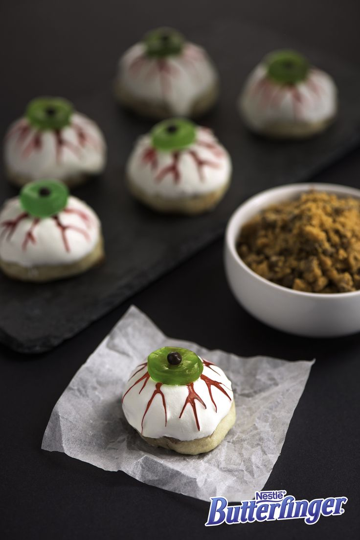 Need a Halloween party pleaser? Follow our steps to make some sweet, Butterfingery shortbread. Then decorate with melted white chocolate, gummy candies, chocolate bits, and scary red icing. Then watch as people can't take their eyes off of these deliciously eerie cookies.