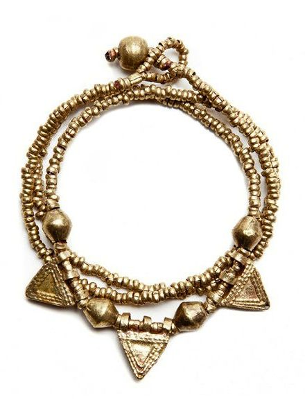 The Asmir gold triangle #wrap #bracelet is made from found artillery shells in the mountains of Northern Ethiopia.  The artillery shells are skilfully made in to beautiful #jewellery by local Ethiopian women. hamlin.org.au