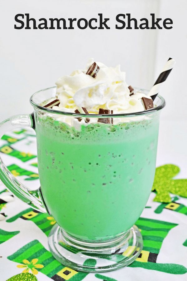 A delicious, green, Shamrock shake is the perfect milkshake for St. Patrick's Day! Made with mint chocolate chip ice cream, milk, and green food coloring, these delicious minty green milkshakes would also make a sweet treat for any day of the year! #Shamrock #StPatricksDay #DessertRecipes #Milkshake