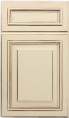 Ivory kitchen cabinetry with antique glaze