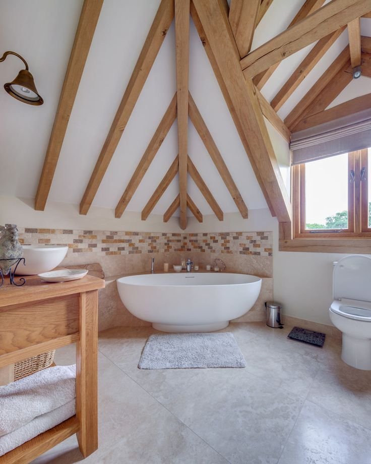 Oak frame can look stunning in bathrooms and can work beautifully with both traditional and modern looks. www.welshoakframe.com #bathroomideas #oakframe #freestandingbath #oakbathroom