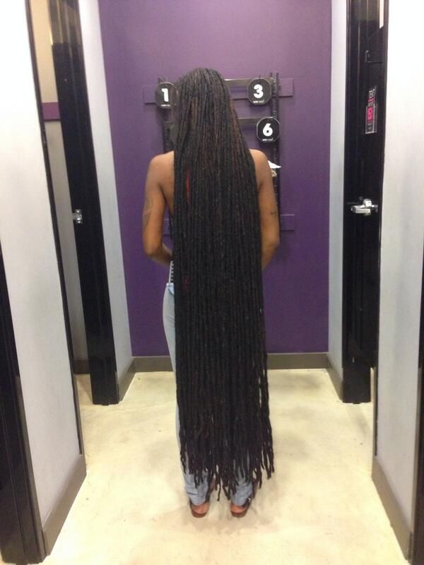 Very long dreads down to her ankles. She's been growing her dreads for 23 years. Wow!