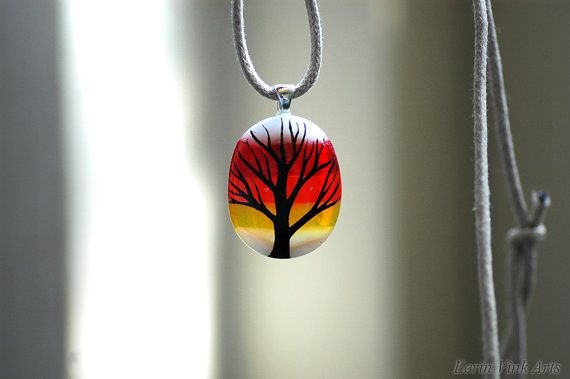 Tree of life jewelry, tree silhouette on fused glass. This artist also makes fantasy paintings and illustrations. You can find her work on this website: eerinvink.etsy.com