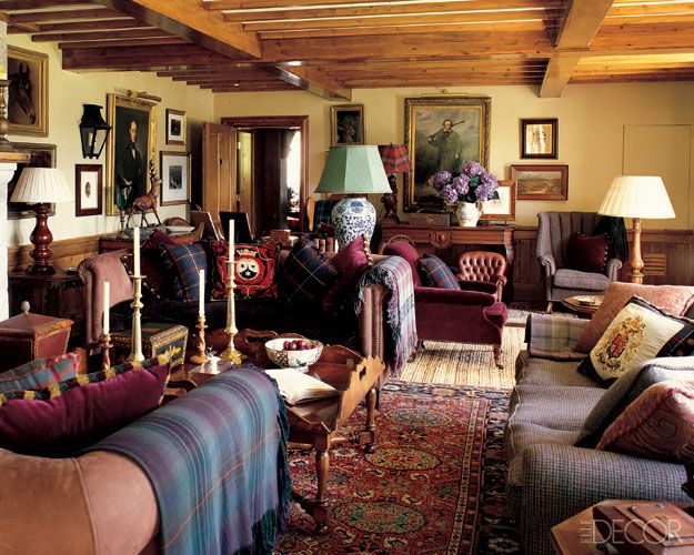A classic drawing room: layered rugs, oriental carpet, tartans, blue and white porcelain, mismatched lamps