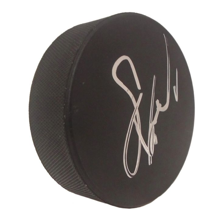 Eric Lindros Autographed Hockey Puck, Proof Photo