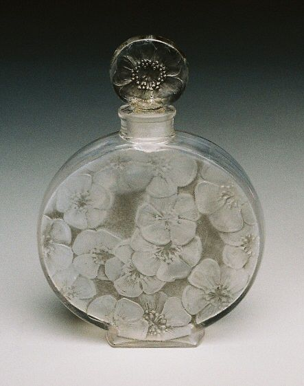 Rare Lalique perfume bottle.  Absolutely LOVE the art of Rene Lalique!  http://www.davidshuttle.com/products/the_summer_sale/1223/