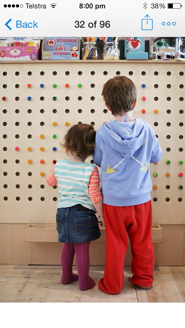 Our custom made peg board where kids can play while parents browse our retail shop and order in our cafe.