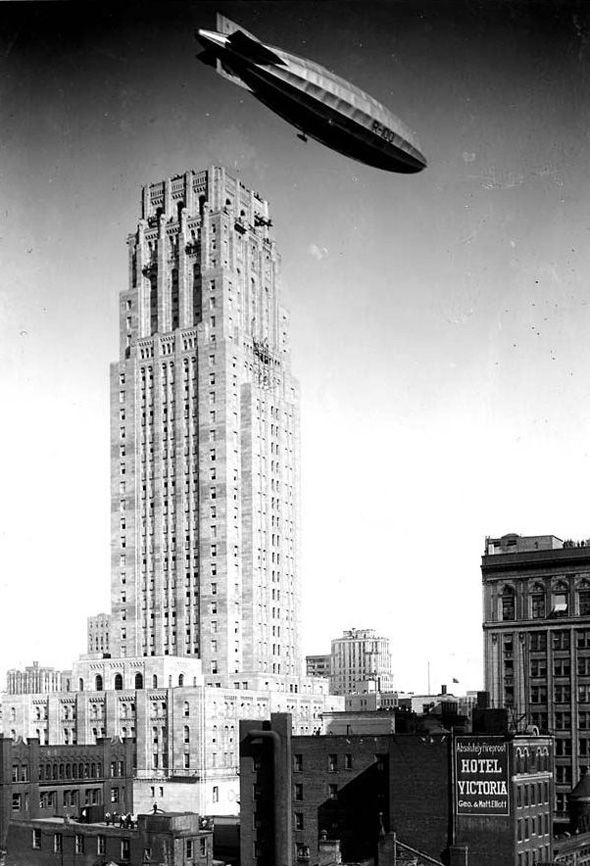 An airship flying past the Canadian Bank of Commerce Building, Toronto, Canada, 1930s