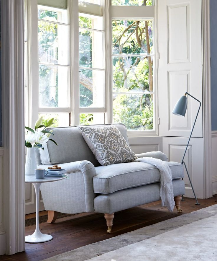 The Bluebell love seat fits snug into this bay window space