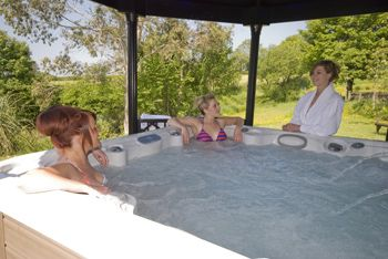 Two luxury holiday cottages with hot tub nestled within beautifully landscaped gardens plus a sauna room to help you relax and unwind in Carmarthenshire country side.