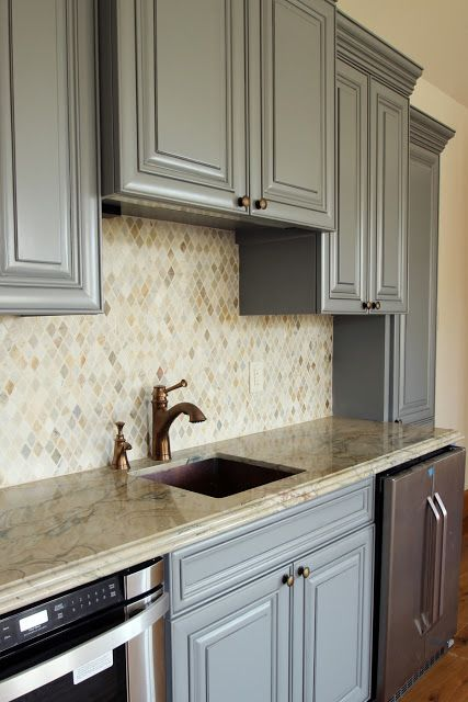 A Neutral Mosaic Backsplash In The Quot Kitchen Quot Area Of A