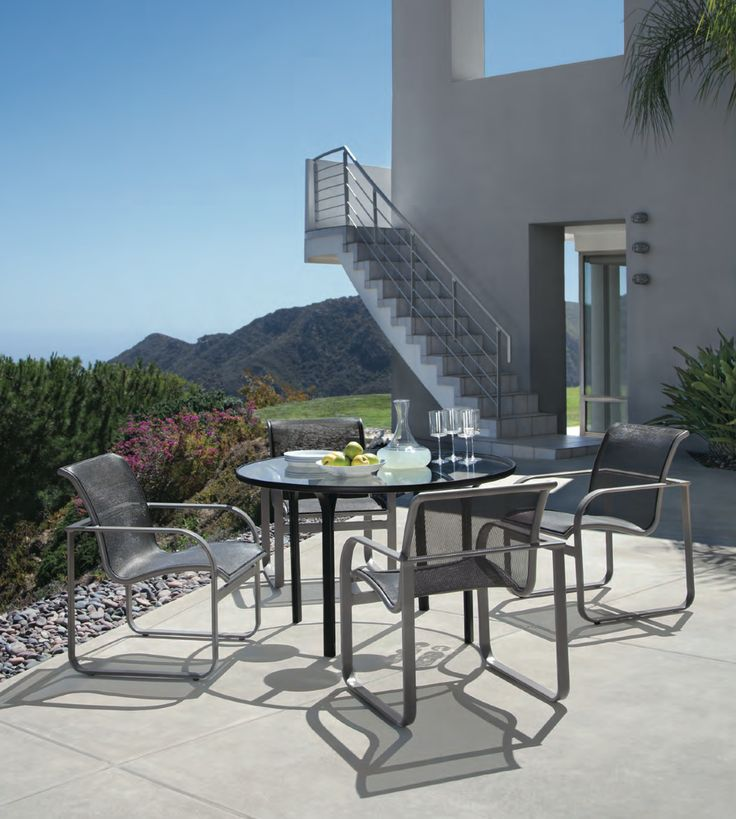 Beautiful Home With Outdoor Luxury Dining Set From The Quantum Parabolic Collection By Brown Jordan