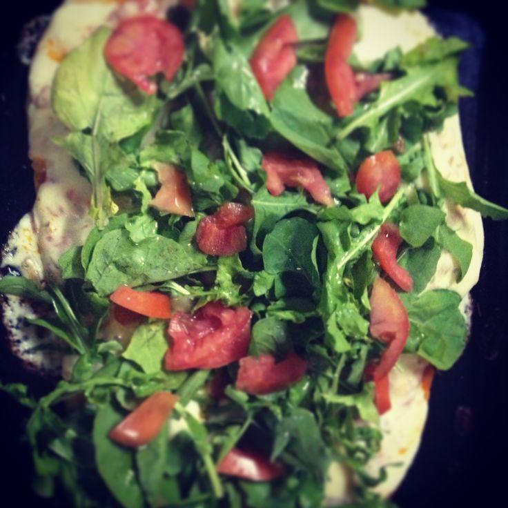 Pizza con rúcula...
